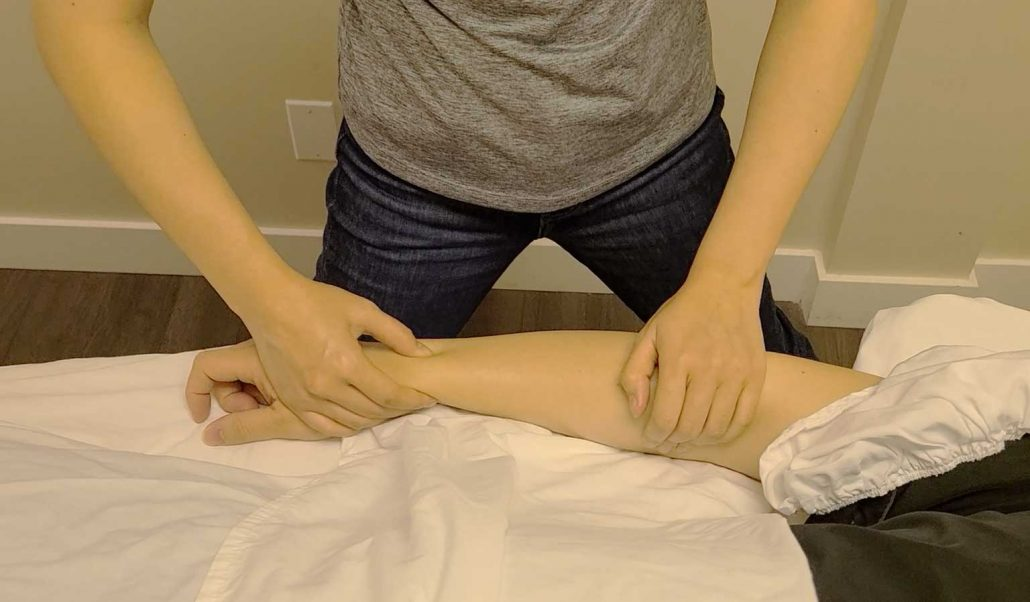 manual therapy technique that is applied to the wrists and the forearm flexor muscles
