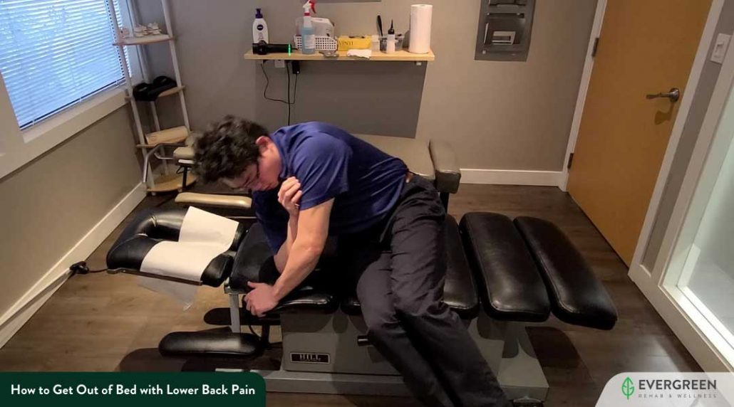 Drop your leg while you push up your arms off the side of your bed to come up with a seated position